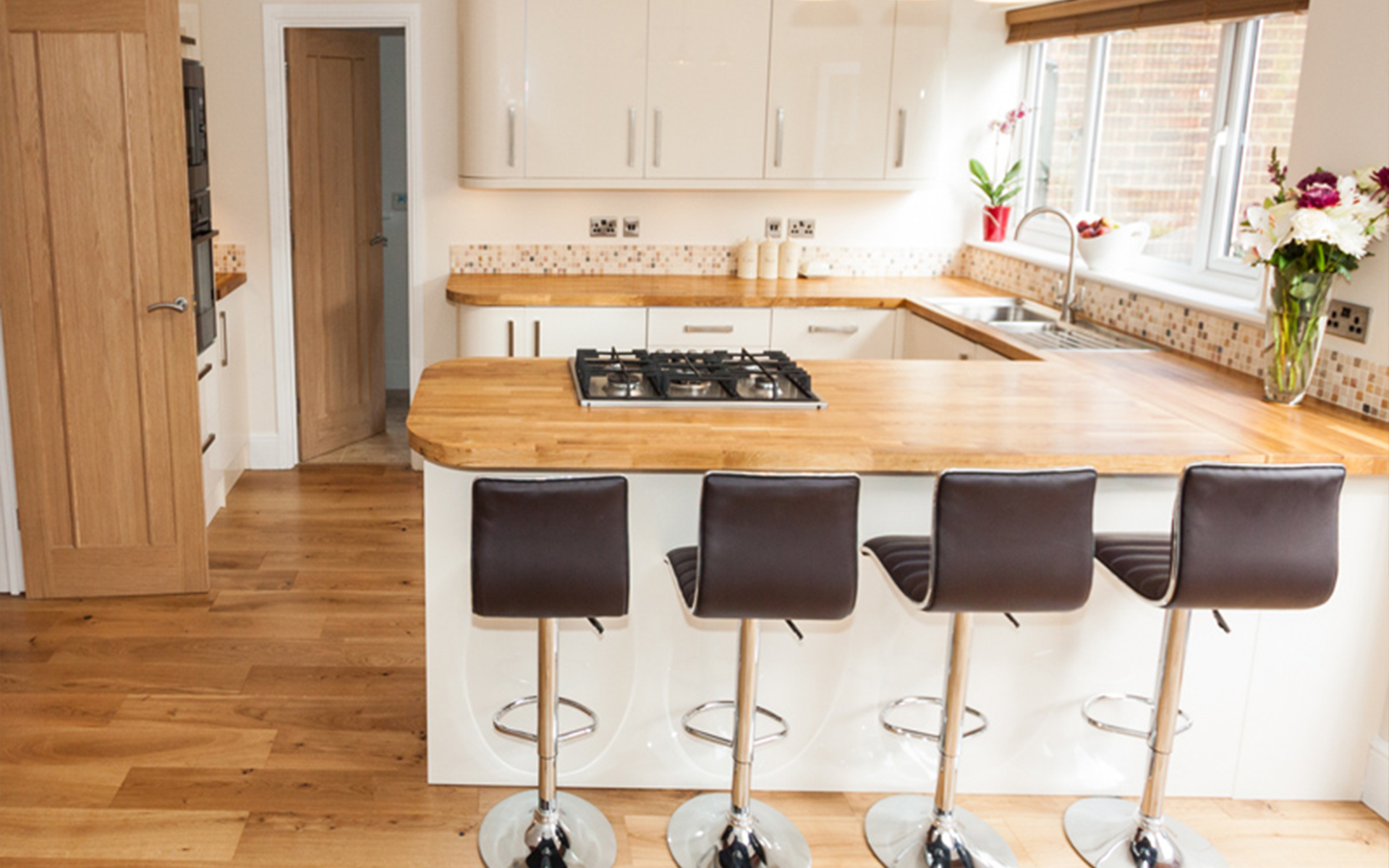 kitchen island counter with leather stools